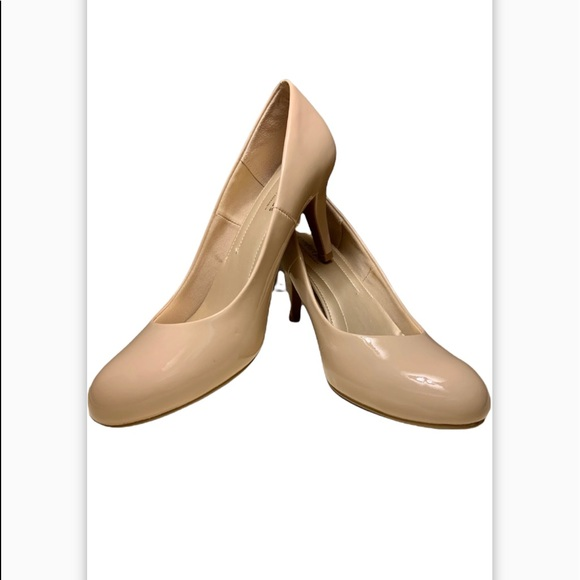 Nude patent pumps with approx 2 1/2 in heel. Almond shape toe